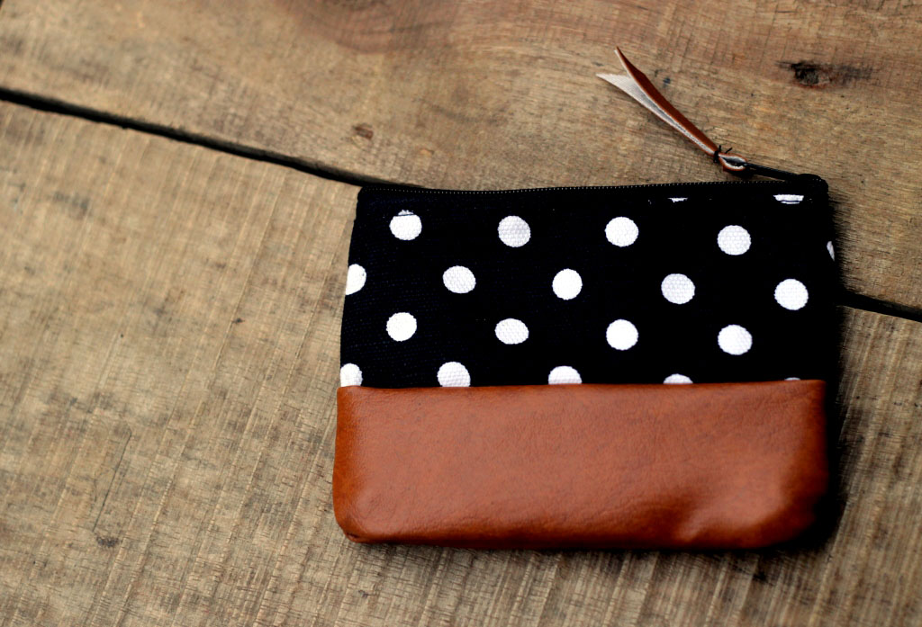Leather pouch combination with polka dot canvas pattern